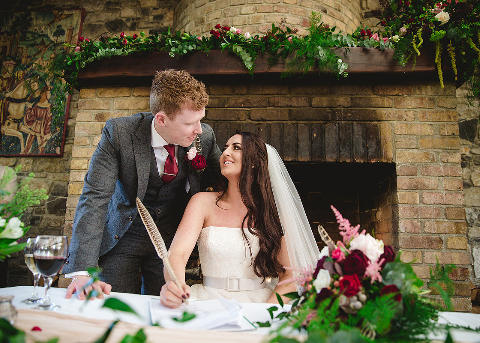 Styled by Amber Wedding Stylist Couple Signing Quill Feather